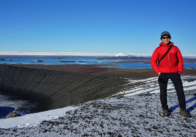 Theron Finley stands near Hverfjall, a cinder cone volcano in northern Iceland located near a geothermal power plant. Finley is travelling around the world to learn how Canada may be able to take advantage of geothermal energy. (Photo: Supplied)
