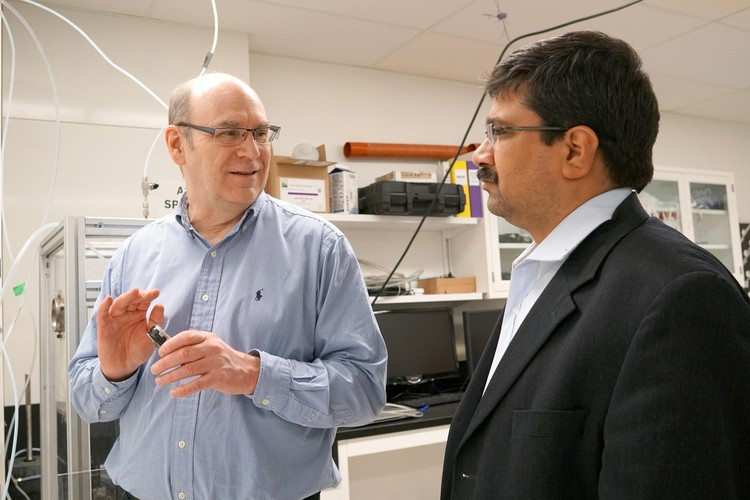 Future Energy Systems Director Larry Kostiuk in his lab with Deputy Director Amit Kumar.