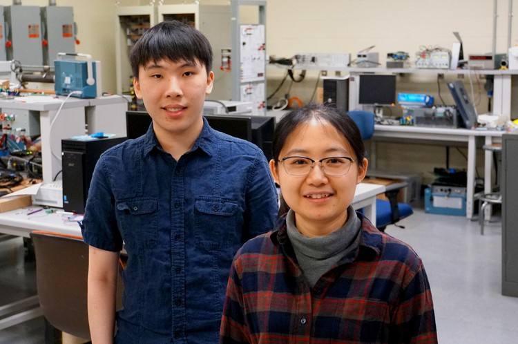Graduate students Andrew Zhou and Tong Shi.