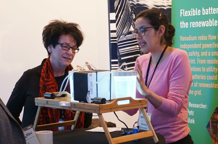 Director Anne Naeth views a demonstration from graduate student Carolina Quiroz Juarez at the SPARK 2019 conference.