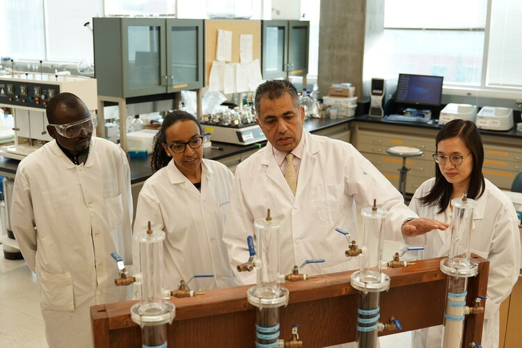 Mohamed Gamal El-Din (second right) with post-doctoral researchers in his U of A lab. Gamal El-Din led a study detailing a new process that efficiently removes one of the main toxic components of water used in oil sands operations.