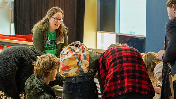 Valerie Miller teaches a group of children across a table at a science event