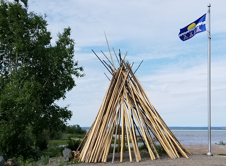 The Tłı̨chǫ Government flag flies in the NWT