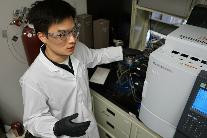 Doctoral student Sheng Zeng explains how their catalyst converts CO<sub>2</sub> into more useful products.